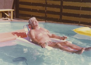 dad floating in our doughboy pool