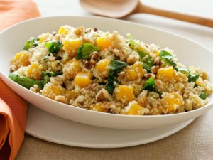 Butternut squash with quinoa, spinach and walnuts